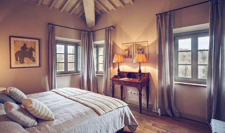 Schlafzimmer der Villa | Foto: Toscana Resort Castelfalfi